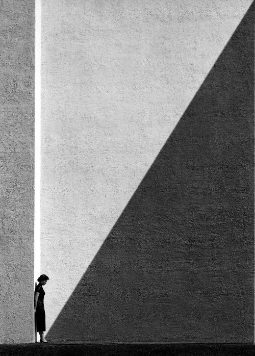 seensense:</p> <p>Approaching Shadow, Hong Kong, 1956/2012, Fan Ho. From Hong Kong Yesterday.</p> <p>The person who took this photograph<br /> is focusing on the approaching shadow.<br /> But when I look at this picture,<br /> all I see is a woman standing alone.<br /> One picture = different perspectives