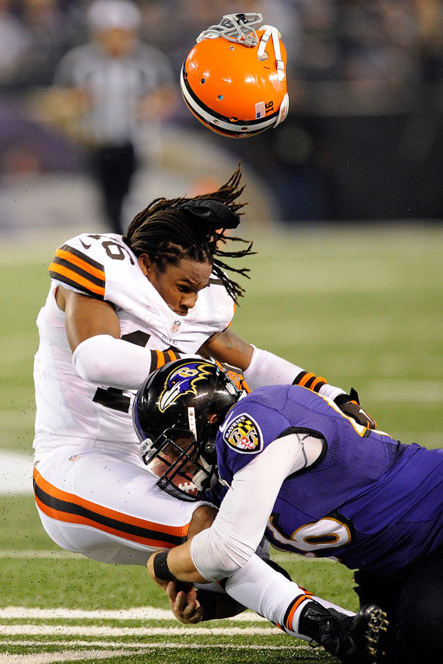 Josh Cribbs loses his helmet after a hit from Morgan Cox during Thursday's Ravens-Browns game. Despite playing their fourth game in 18 days, Baltimore defeated Cleveland 23-16. The Browns fell to 0-4 with the loss and remain the only winless team in the AFC. (AP Photo/Nick Wass)<br /> BURKE: Browns winless but not hopelessKING: Week 4 picks | Fantasy projections