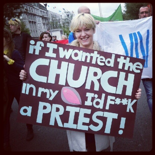 "Woman carrying a sign saying ""If I wanted the church in my *** I'd f*ck a priest!"""