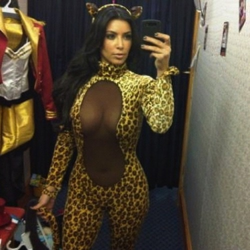 kim kardashian gets catty for halloween by trying a costume on for size