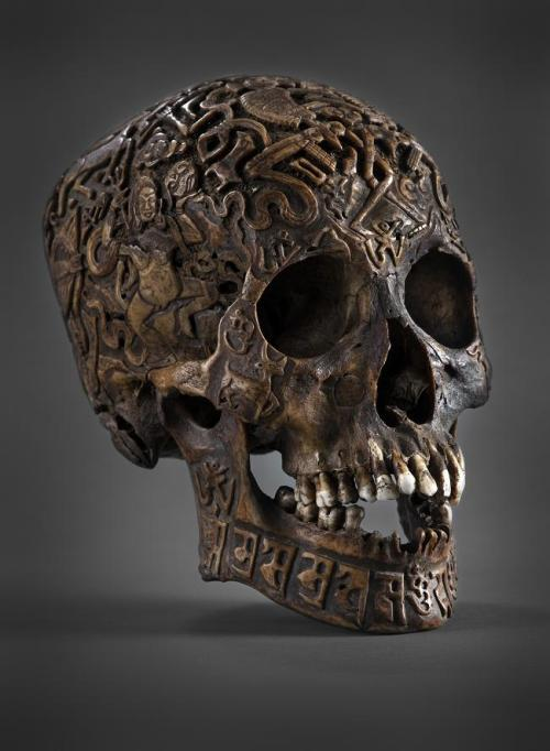 Tibetan skull art and the botton is a tibetan shaman mask. The skull art is more common. The shaman mask is actually quite rare. HALLOWEEN APPRO I THINK SO!!