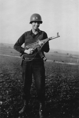 "10. 1st Lt. Hightower with his ""Burp Gun"".  Lt. Hightower said he was ""hunting jack rabbits with his Burp Gun."" Germany 1945"
