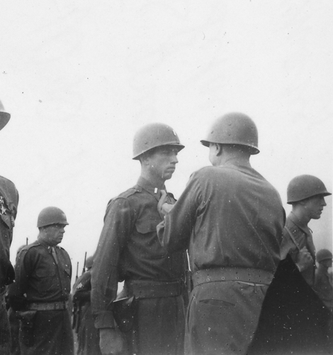 54. 1st Lt. being presented the Silver Star by Gen. Patton 1945 Cham Germany