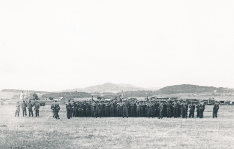 79. The 244th on parade ground south side of Cham Germany May 1945