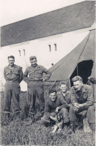 173. L to R. Tec/5 Earl E. Keener, Cpl. Dudley J. Chandler, Miff, Grepe, 1st. Lt. Jacob W. Shinaberry, and Eto the dog Tedražice Czechoslovakia