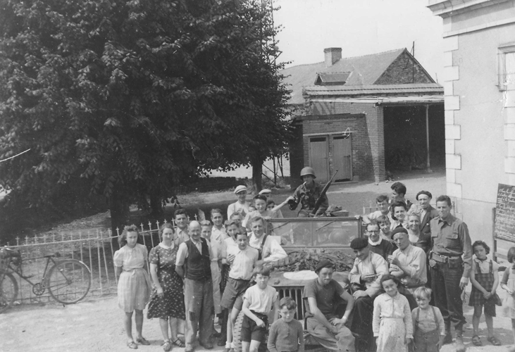 192. Lt. Marriott, his jeep and driver are surrounded by towns people outside Zámek Hrádek, Headquarters of the 244th in Hrádek u Sušice