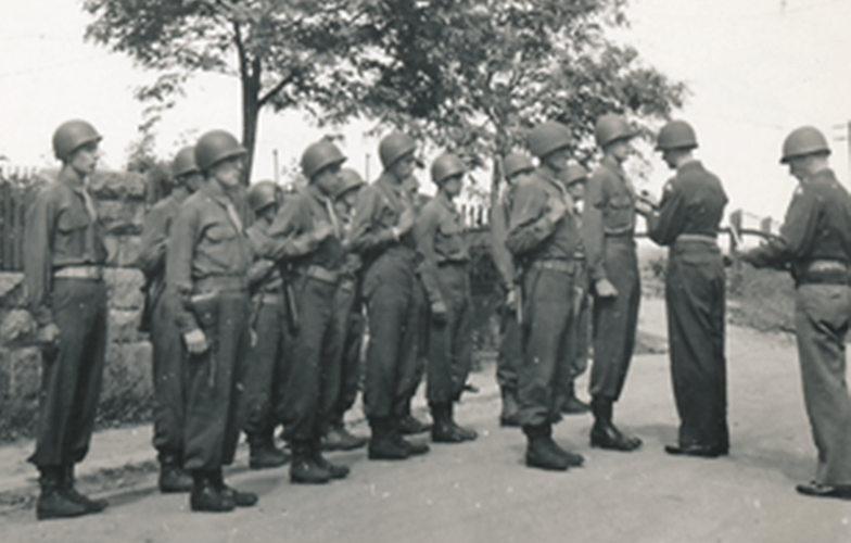 58a. Enlargement of photo No.58. Enlisted members receiving awards, Cham Germany. Major Carey A. Clark, Major Robert G. Humphrey presenting Bronze Stars Cham Germany