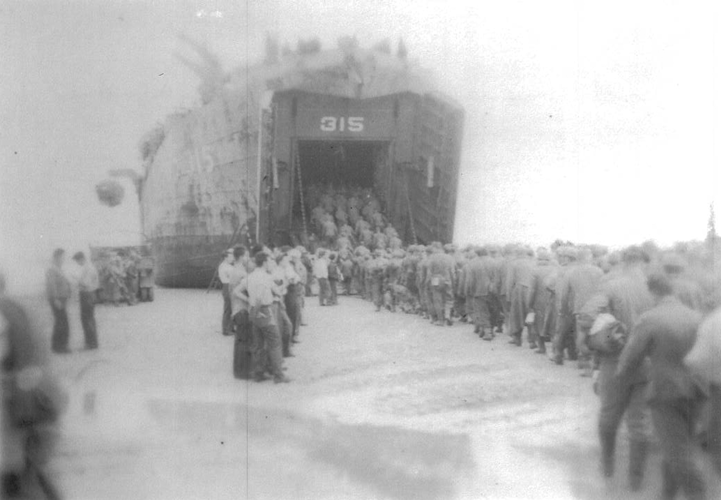 593. LST 315 brings the 244th from England and takes German POW's for transport.