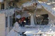 A Syrian Arab Red Crescent (SARC) member inspects the damage at SARC centre after it was hit at dawn by an airstrike in the rebel-held Idlib City, Syria.