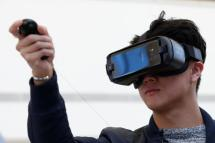 A guest uses the Samsung Gear VR for the Samsung Galaxy S8 during the Samsung Unpacked event in New York City, U.S.