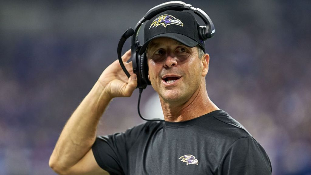 Ravens coach John Harbaugh pays the bill for...