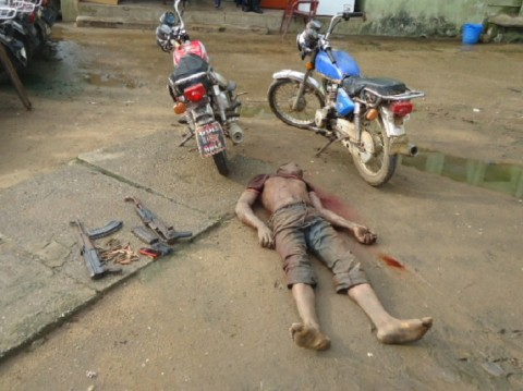 BODY OF THE DEAD KIDNAPPER, TWO MOTORCYCLES, TWO AK47 AND TWO MOBILE PHONES RECOVERED DURING THE POLICE RAID