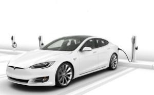 Tesla ofera incarcatoare gratuite pentru parcarile de firma