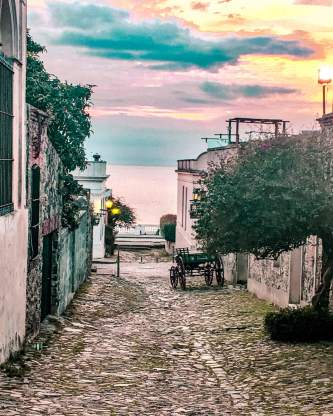 sunset colonial cobblestone street