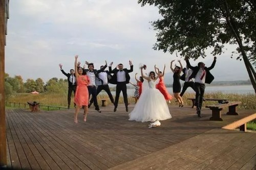 Wedding planning-bride and guest jumping happy