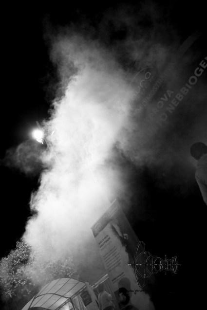 Smoke over a village fair.