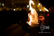 A counter protestor burns a PEGIDA paper asking people to join PEGIDA rallies after what happened in PAris.