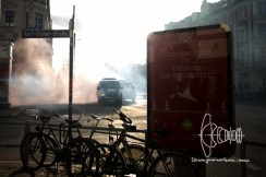 Tear gas and smoke bombs cover the area.