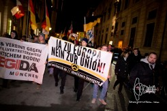 """Identitarians march up front with PEGIDA Munich and shout: """"Festung Europa - macht die Grenzen dicht!"""" (""""Fortress Europe - close down all borders!"""")"""