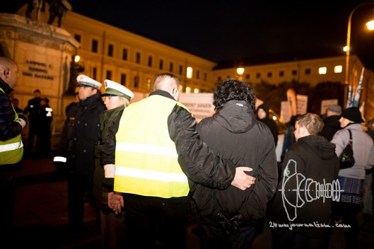 Petra K. - always shows up with group of convicted neo-nazi terrorists - gets a friendly hug from Stefan S. after attacking press members.