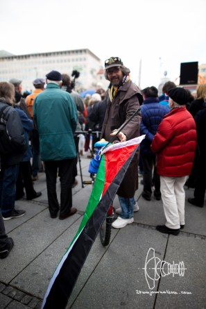Man with Palestinian flag.