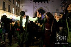 Kurds in traditional clothing dancing.