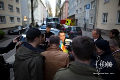 Press official of the Munich Police Departement speaking to cameras and reporters as the shooters is laying on theground one block away threatening police forces with suicide