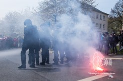 Neo-nazis launch pyrotechnics on police.