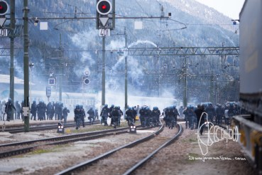 Tensions errupt on the traintracks. Teargas is launched by police.