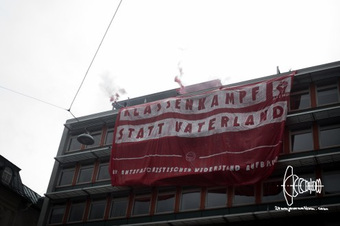 Approximately 1500 participated in a demosntration against the to be decided integration law in Munich. Activists lowered a banner from the worker's union building.