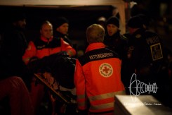 Medical staff helps collapsed non-citicens.