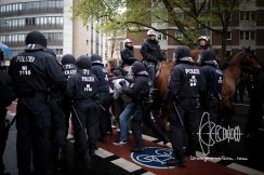 Protestors get pushed off by police as AfD members arrive