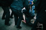 A police man tackles an attacker.