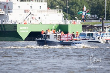 Boat with anti G20 banner.