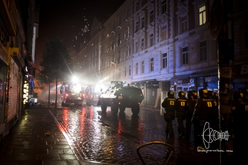 Pyrotechnics explode next to water-cannon