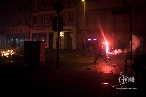 Flare is thrown at police