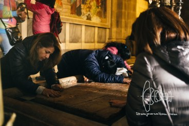 People praying at the Church of the Holy Sepulchre