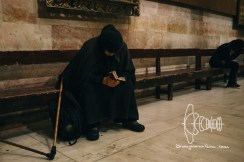 Elderly woman praying at the Church of the Holy Sepulchre