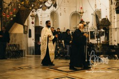 Before christmas service in Bethlehem a priest circles the chruch.