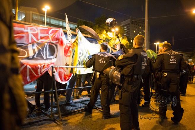 Police filming counter protestors.