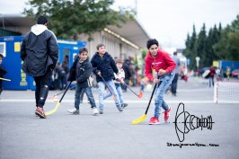 Children play hockey to distract themselves from the situation.