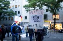 PEGIDA member demanding german chancellor Merkel to quit.