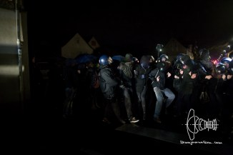 Counter protestors get removed off street by police.