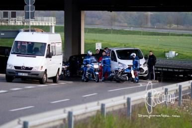 ´Police men with fallen over bike.