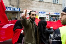 Participant holding up his index finger, a sign used by DAESH/ISIS.