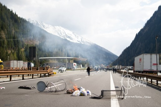 Small barricades burn on the highway.