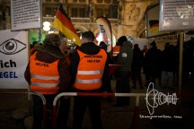 Racist vests declaring that the one's wearing to be supporters in deportations. On Monday January 16th PEGIDA gathered on Marienplatz in Munich for it's second anniversary. Many people demonstrated against the event. Police ripped away banners of counter protestors declaring they are not necessary for democratic protest. Many neonazis of far-right party 'Der III. Weg' participated.