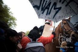 Policeman on a horse rides into counter-protest.