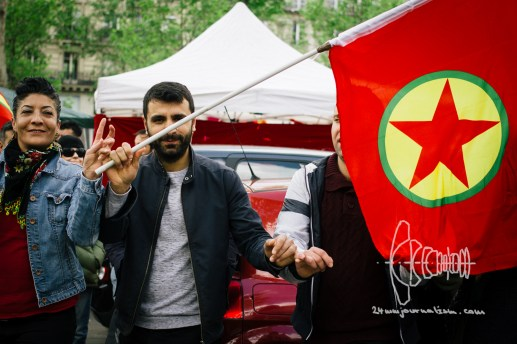 Solidary with the Kurdish workers' party people dance and hold ab PKK flags.