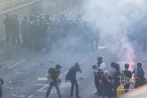 Journalists in smoke.